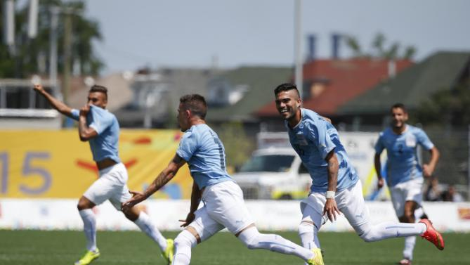 Uruguay's Brian Lozano, second left, celebrates with teammates after scoring against Mexico during the men's gold medal soccer match at the Pan Am Games in Hamilton, Ontario, Sunday, July 26, 2015. (AP Photo/Felipe Dana)